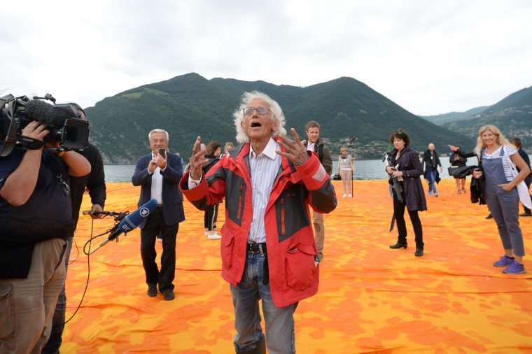 "Artist Christo Vladimirov Javacheff walks on his monumental installation ""The Floating Piers"" he created with late Jeanne-Claude, on June 16, 2016 during a press preview at the lake Iseo, northern Italy. (FILIPPO MONTEFORTE/AFP/Getty Images)"
