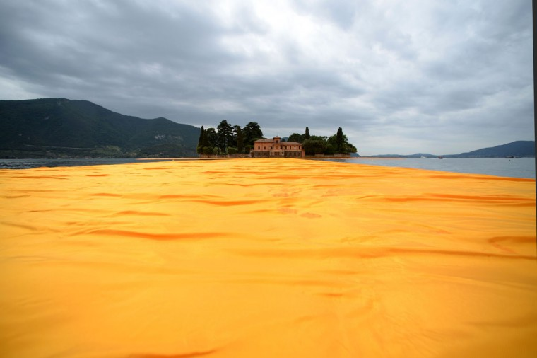 "A picture shows the monumental installation ""The Floating Piers"" created by Artist Christo Vladimirov Javacheff and Jeanne-Claude, on June 16, 2016 during a press preview at the lake Iseo, northern Italy. (FILIPPO MONTEFORTE/AFP/Getty Images)"