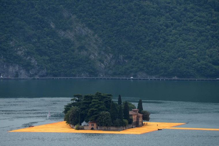 "A picture shows a partial view of the monumental installation ""The Floating Piers"" created by artist Christo Vladimirov Javacheff and Jeanne-Claude, on June 16, 2016 during a press preview at the lake Iseo, northern Italy. (FILIPPO MONTEFORTE/AFP/Getty Images)"