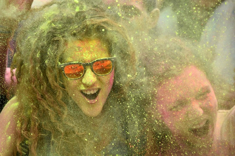 "People take part in a battle of colors during the ""Roma Colours"" event on June 29, 2016 in Rome. (GABRIEL BOUYS/AFP/Getty Images)"
