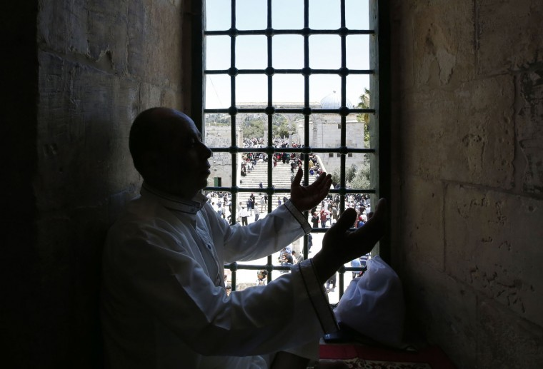 Palestinian Muslim worshippers perform Friday prayer at the al-Aqsa mosque compound in Jerusalem's old city on June 17, 2016 during the holy fasting month of Ramadan. Around 53,000 Palestinians from the West Bank were allowed into Jerusalem to pray at Al-Aqsa, an Israeli spokeswoman said. (Ahmad Gharabli/AFP/Getty Images)