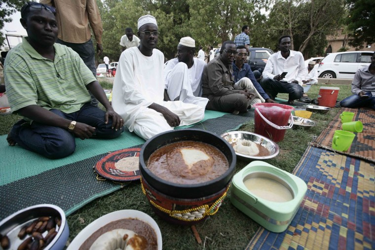 Sudanese arrive to share a picnic at a park on Nile Street as they break the fast during the Muslim holy fasting month of Ramadan on June 17, 2016 in the capital Khartoum. (Ebrahim Hamid/AFP/Getty Images)