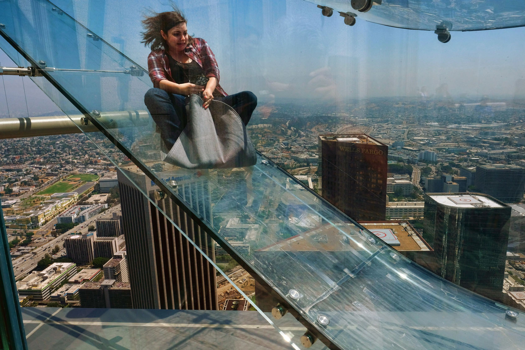 Thrill-seekers test Skyslide in Los Angeles