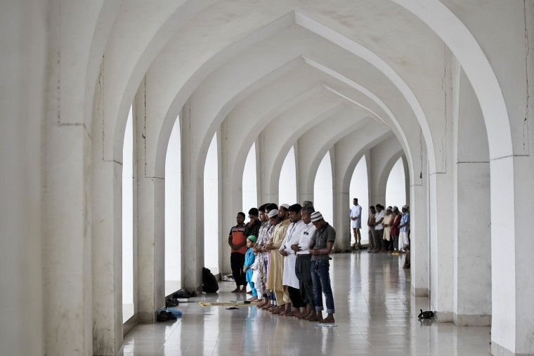 Muslims pray on the second Friday of the holy month of Ramadan in Dhaka, Bangladesh, Friday, June 17, 2016. Observant Muslims abstain from eating and drinking from dawn to dusk for the entire month of Ramadan. A single sip of water or a puff of a cigarette is enough to invalidate the fast. (AP Photo/ A.M. Ahad)