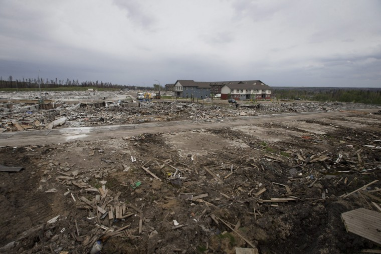 The devastated neighborhood of Timberlea in Fort McMurray, Canada is shown on Wednesday June 1, 2016. Residents started to return to the fire-damaged city in northern Alberta on Wednesday, but officials have warned that they should not expect everything to be running normally right away. (Jason Franson/The Canadian Press via AP)