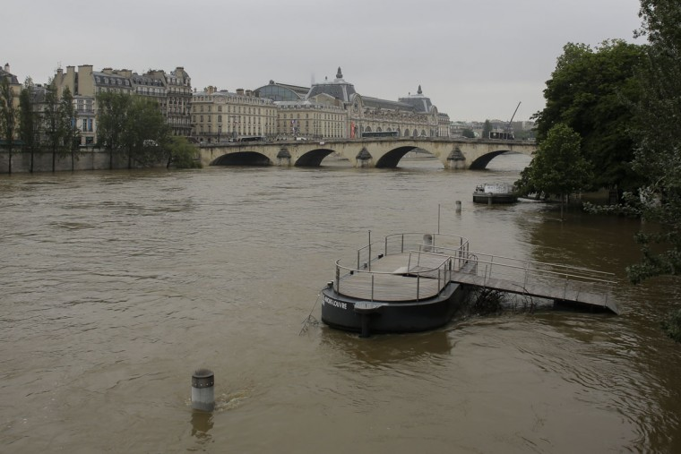 A pier near is partially submerged by the river Seine in Paris, Wednesday, June 1, 2016. Paris City Hall closed roads along the shore of the Seine from the southwest edge of the city to the neighborhood around the Eiffel Tower as the water level has risen 4.3 meters (14 feet 1 inches) higher than usual. (AP Photo/Markus Schreiber)