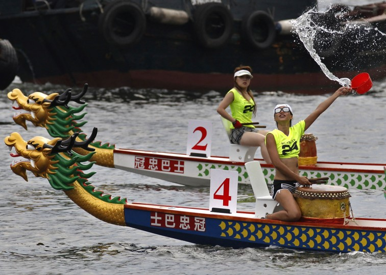 Participants splash water after a dragon boat race in Hong Kong Thursday, June 9, 2016, as part of celebrations marking the Chinese Dragon Boat Festival, held throughout Hong Kong. (AP Photo/Vincent Yu)