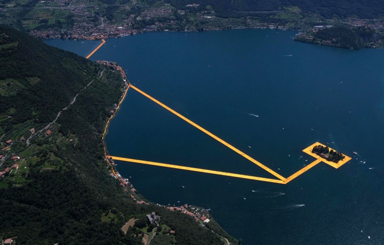 An aerial view of the installation 'The Floating Piers' by Bulgarian-born artist Christo Vladimirov Yavachev known as Christo, on the Lake Iseo, northern Italy, Saturday, June 18, 2016. (Filippo Venezia/Ansa via AP)