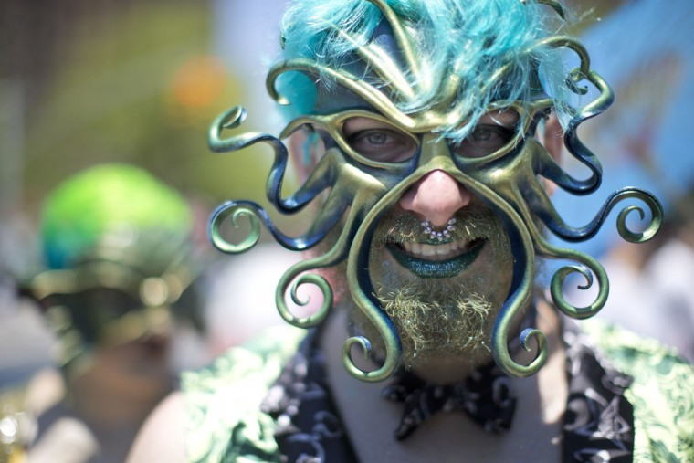 A participant poses for a photo in the staging area before marching in the 34th Annual Mermaid Parade, Saturday, June 18, 2016, in New York's Coney Island. (AP Photo/Mary Altaffer)
