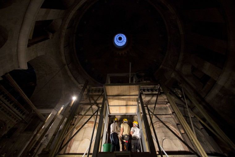 A Greek team of experts begin renovation of Jesus' tomb in the Church of the Holy Sepulchre in Jerusalem's old city, Monday, June 6, 2016. A team of experts has begun a historic renovation at the spot where Christians believe Jesus was buried, overcoming longstanding religious rivalries to carry out the first repairs at the site in over 200 years. (AP Photo/Ariel Schalit)