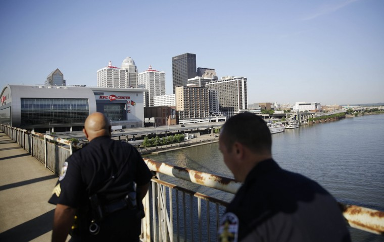 Police patrol along a bridge before a funeral procession begins for Muhammad Ali Friday, June 10, 2016, in Louisville, Ky. (AP Photo/David Goldman)