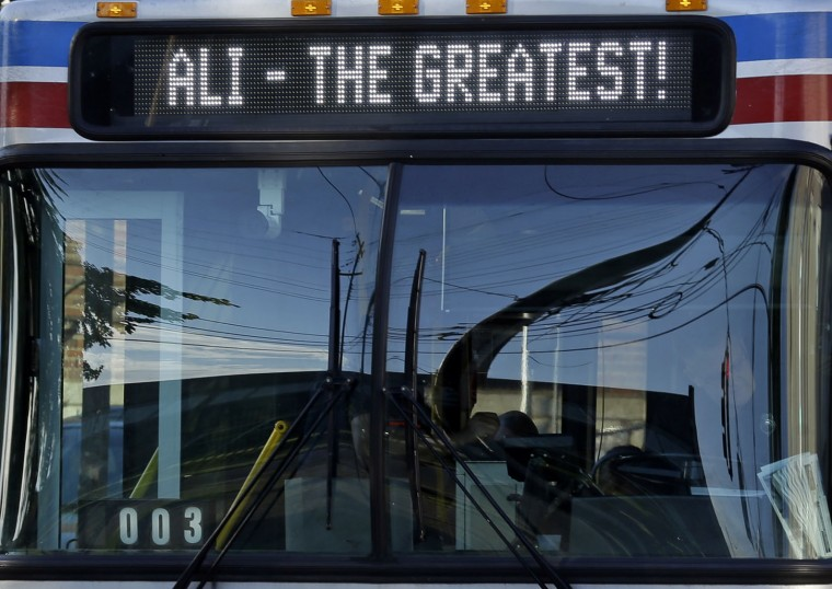 A Louisville bus carries a salute to Muhammad Ali in Louisville, Ky. Friday, June 10, 2016. Ali's body will ride in a miles-long procession spanning his life — from his boyhood home where he shadowboxed and dreamed of greatness to the boulevard that bears his name and the museum that stands as a lasting tribute to his boxing triumphs and his humanitarian causes outside the ring. Ali died last Friday at 74 after a long battle with Parkinson's disease. (AP Photo/Michael Conroy)