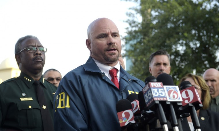 FBI assistant special agent in charge Ron Hopper, center, answers questions from members of the media after a fatal shooting at Pulse Orlando nightclub in Orlando, Fla., Sunday, June 12, 2016. Listening at left is Orange County Sheriff Jerry Demings. (AP Photo/Phelan M. Ebenhack)
