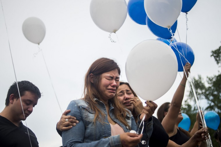 Iris Vargas embraces her sister, Joanna Vargas, as hundreds of friends and family membes gathered for a vigil remembering Luis S. Vielma, whose death was announced by officials, Monday, June 13, 2016 in Sanford, Fa., Monday, June 13, 2016. Vigils, rallies and marches are being held around the country Monday for the victims of early Sunday's deadly attack at a gay nightclub in Orlando. (Zack Wittman/Tampa Bay Times via AP)