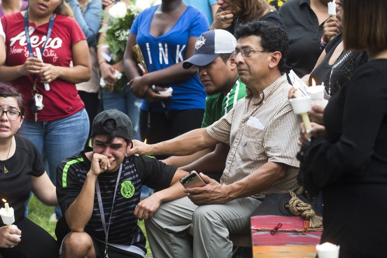 Luis Laguna, center, left, falls to his knee in tears while Jose Vielma comforts him as hundreds of friends and family members gathered for a vigil remembering Luis S. Vielma, whose death was announced by officials, Monday, June 13, 2016 in Sanford, Fa., Monday, June 13, 2016. Vigils, rallies and marches are being held around the country Monday for the victims of early Sunday's deadly attack at a gay nightclub in Orlando. (Zack Wittman/Tampa Bay Times via ALuis Laguna, center, left, falls to his knee in tears while Jose Vielma comforts him as hundreds of friends and family members gathered for a vigil remembering Luis S. Vielma, whose death was announced by officials, Monday, June 13, 2016 in Sanford, Fa., Monday, June 13, 2016. Vigils, rallies and marches are being held around the country Monday for the victims of early Sunday's deadly attack at a gay nightclub in Orlando. (Zack Wittman/Tampa Bay Times via AP)