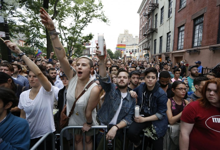 Crowds react as they listen to speakers during a vigil and memorial for victims of the Orlando nightclub shootings near the historic gay bar, the Stonewall Inn, Monday, June 13, 2016, in New York. State and city officials, LGBT community members, and others gathered as a show of solidarity with the victims and survivors of the Orlando nightclub shootings, the worst mass shooting in modern U.S. history. (AP Photo/Kathy Willens)