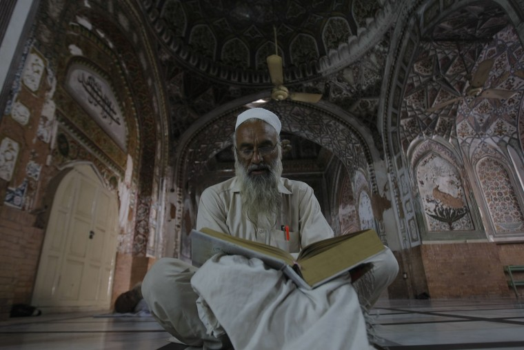 A Pakistani Muslim recites the Quran at a mosque during the Islamic month of Ramadan, in Peshawar, Pakistan, Friday, June 17, 2016. Muslims across the world are observing the holy fasting month of Ramadan, when they refrain from eating, drinking and smoking from dawn to dusk. (AP Photo/Mohammad Sajjad)