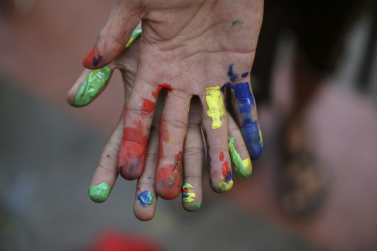 Filipino youth activists show they hands painted in rainbow colors as they gather in solidarity with victims of the mass shooting at the Pulse nightclub in Orlando, Florida during a gathering in Manila, Philippines on Tuesday June 14, 2016. The group calls for justice for the victims of the mass shooting. (AP Photo/Aaron Favila)