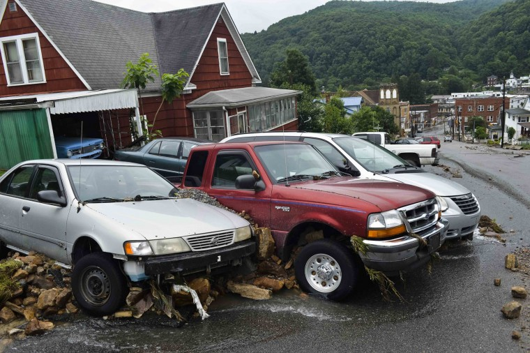 Cars and large rocks are smashed together after being carried down Oakford Avenue by flood waters in Richwood, W.Va. on Friday June 24, 2016. (Christian Tyler Randolph/Charleston Gazette-Mail via AP)