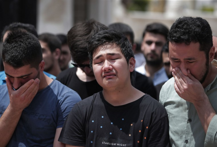 Relatives of Habibullah Sefer, one of the victims killed Tuesday at the blasts in Istanbul's Ataturk airport, weep close to his coffin, during the funeral in Istanbul, Thursday, June 30, 2016. Suicide attackers killed dozens and wounded scores of others at the busy airport late Tuesday, the latest in a series of bombings to strike Turkey in recent months. Turkish authorities have banned distribution of images relating to the Ataturk airport attack within Turkey. (AP Photo/Lefteris Pitarakis)