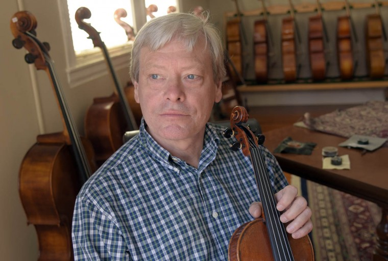 "Rodger Perrin, founder of Perrin and Associates Fine Violins in 1994, is pictured in one of the showrooms. The company makes, repairs and restores violins and cellos for the aspiring to the accomplished musician. Perrin says, ""I was passionate about Mozart and Beethoven when I was five years old."" His love for classical music progressed from playing violins to building, restoring and repairing violins, violas and cellos. (Algerina Perna/Baltimore Sun)"