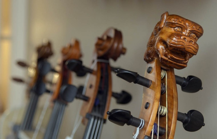 In the foreground is a carved scroll of a modern replica of a Baroque cello. (Algerina Perna/Baltimore Sun)
