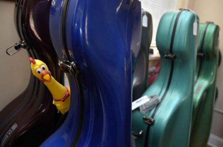 While being exacting in their work, the craftsmen at Perrin & Associates retain their sense of humor with the help of this rubber chicken. The chicken -currently attached to cello cases- has a note on it's back directing the finder to move it to another place. (Algerina Perna/Baltimore Sun)