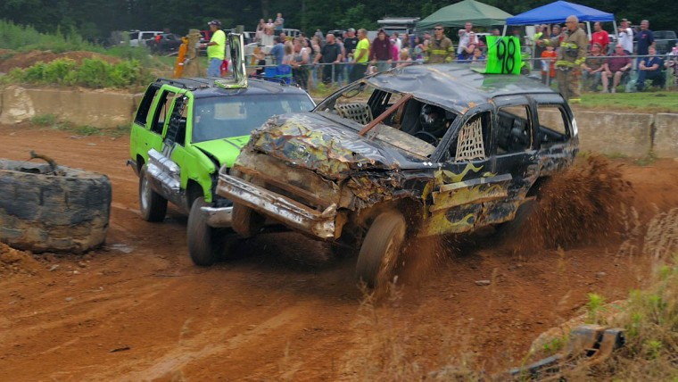 One SUV T-bones another, almost causing it to flip, but it returns to the track to continue during Demo Derby Day at Arcadia Volunteer Fire Company's carnival grounds. (Karl Merton Ferron/Baltimore Sun)