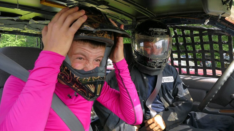 Colin Bartley, 16 of Arbutus puts his helmet on, next to driver David Greene of Arbutus, who buckles in preparation of their race during Demo Derby Day at Arcadia Volunteer Fire Company's carnival grounds. (Karl Merton Ferron/Baltimore Sun)