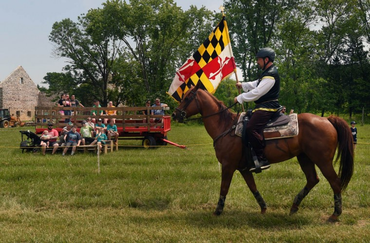 The audience are treated to a Medieval costumed parade by the jousters before the tournament begins at Amateur Jousting Club of Maryland's 2016 Founder's Day Joust at the historic Jerusalem Mill Village. Traditional ring joust is a test of skill and horsemanship where riders pass through a series of arches, attempting to spear three dangling rings. Ring diameters range from one and three quarter inches for novices to one inch for professional jousters. Ring sizes go down to as small as a quarter inch to break ties in order to declare a winner. (Kenneth K. Lam, Baltimore Sun)