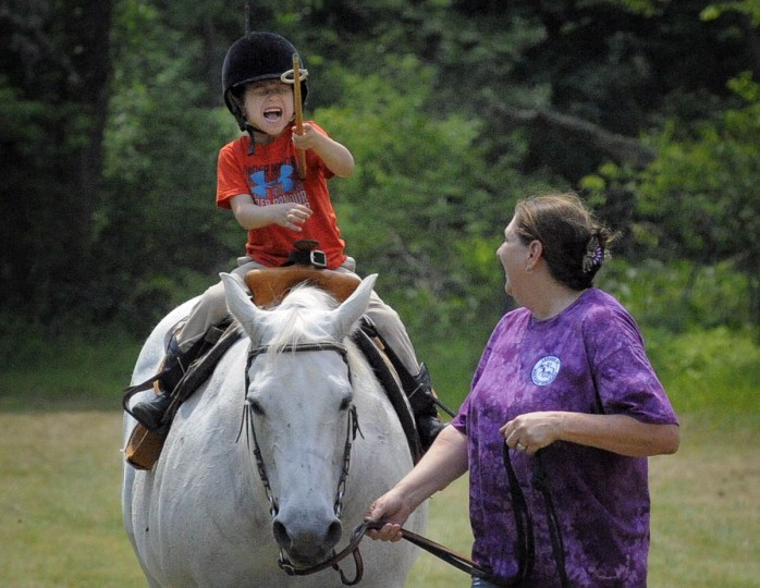 Luke Solomon, 4, of Nottingham, who is jousting for the first time, just missed a ring as he and his horse are led by his grandmother Joyce Barnett through the course. Amateur Jousting Club of Maryland held its 2016 Founder's Day Joust at the historic Jerusalem Mill Village. Traditional ring joust is a test of skill and horsemanship where riders pass through a series of arches, attempting to spear three dangling rings. Ring diameters range from one and three quarter inches for novices to one inch for professional jousters. Ring sizes go down to as small as a quarter inch to break ties in order to declare a winner. (Kenneth K. Lam, Baltimore Sun)