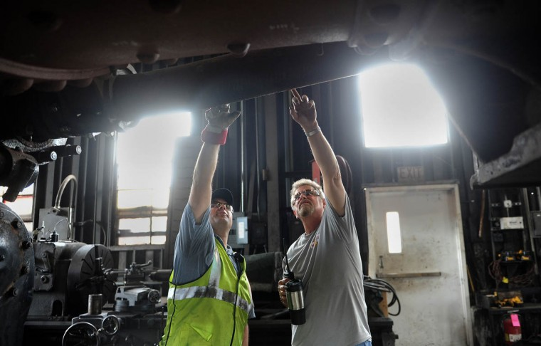 Jim Montague, left, fleet manager, and Mike McMarlin, right, an engineer, look at the boiler of the 1309 C & O steam locomotive that's being restored at the Western Maryland Scenic Railroad. When the restoration is complete, probably next year, the locomotive will pull passenger cars on the scenic railroad. (Barbara Haddock Taylor, Baltimore Sun)