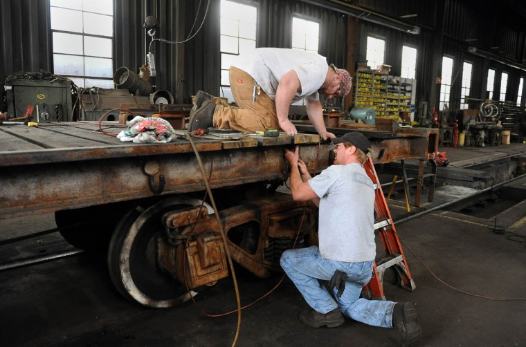 Shop foreman Scott Nixon, left, and mechanic Bruce Snyder, right, install mounting brackets for new boards on the 1309 tender frame. They're working in the shop at the Western Maryland Scenic Railroad yard, where restoration work is being done on the Chesapeake and Ohio Railroad No. 1309 steam locomotive. When the restoration is complete, probably next year, the locomotive will pull passenger cars along the scenic railroad between Cumberland and Frostburg. (Barbara Haddock Taylor, Baltimore Sun)