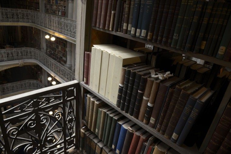"The Peabody Library's collection reflects the priorities and interests of patrons in the late 19th and early 20th centuries. ""It provides kind of a snapshot in time to what they thought was important,"" says curator Paul Espinosa. (Christina Tkacik/Baltimore Sun)"
