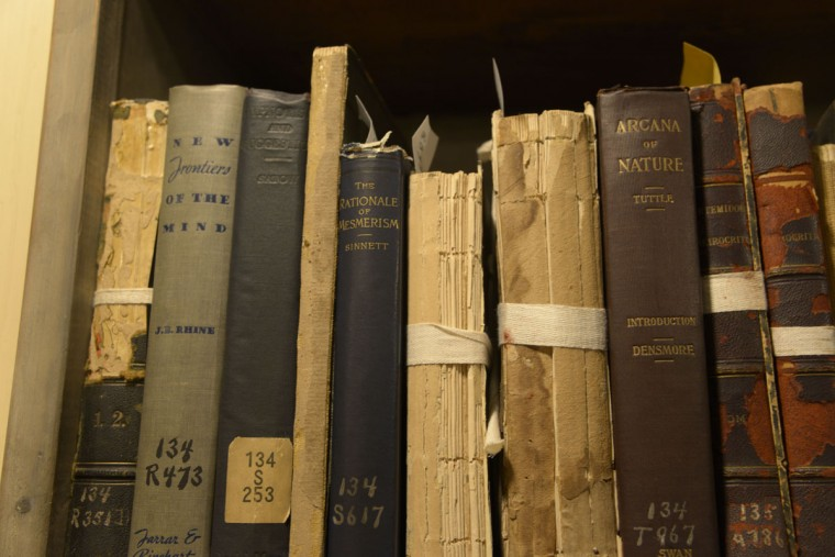 The Peabody Library's primary collection includes books from 1700 up to around the 1940s. Some books on the sixth floor cover quasi-spiritual topics like voodoo, witchcraft and life after death. (Christina Tkacik/Baltimore Sun)