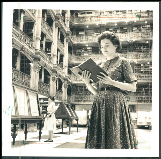 A woman reads at the Peabody Institute Library in  1965. (Hutchins/ Baltimore Sun)