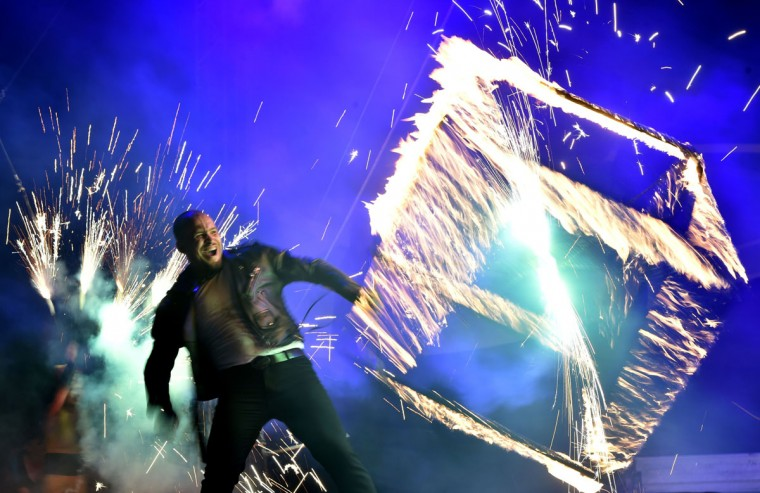 """A costumed artist performs with a cube fire during International Kiev Fire Fest show in Kiev on June 11, 2016. Teams from Greece, Belarus, Lithuania, Slovakia, USA, Czech Republic, Scotland and Ukraine, take part with their fire-shows in the two-day """"Kiev Fire Fest"""" in Kiev. (AFP/Getty Images)"""