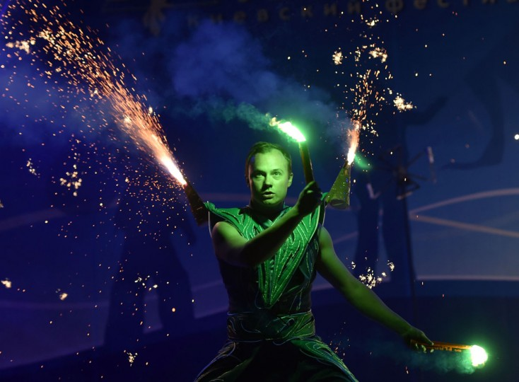 """A costumed artist performs with smoke flares during International Kiev Fire Fest show in Kiev on June 11, 2016. Teams from Greece, Belarus, Lithuania, Slovakia, USA, Czech Republic, Scotland and Ukraine, take part with their fire-shows in the two-day """"Kiev Fire Fest"""" in Kiev. (AFP/Getty Images)"""
