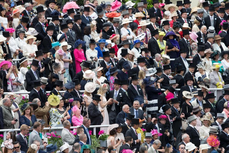 Racegoers gather around the parade ring on the first day of the Royal Ascot horse racing meet in Ascot, west of London on June 14, 2016. (JUSTIN TALLIS/AFP/Getty Images)