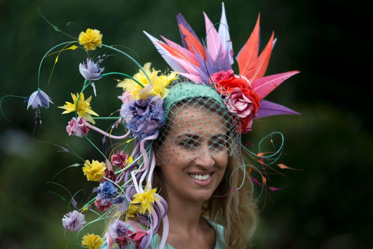 A racegoer poses for photographers on the first day on the first day of the Royal Ascot horse racing meet, in Ascot, west of London, on June 14, 2016. (JUSTIN TALLIS/AFP/Getty Images)