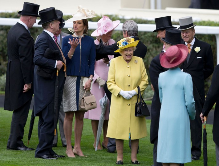 Britain's Queen Elizabeth II (center) and Britain's Prince Philip, Duke of Edinburgh speak to guest in the parade ring on the first day of the Royal Ascot horse racing meet in Ascot, west of London on June 14, 2016. (JUSTIN TALLIS/AFP/Getty Images)
