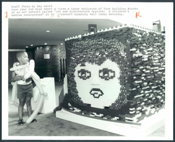 "Four year old Ryan Scott admires a large sculpture of Tyco building blocks at an art exhibit called ""Art and Architecture Applied; A Children's Medium Interpreted"" at the Meyerhoff Symphony Hall lobby Saturday. 1988. (Davis/Baltimore Sun)"