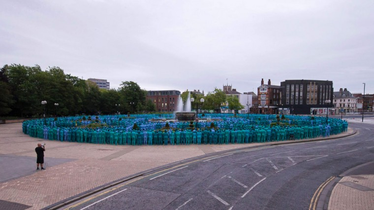 "Naked volunteers, painted in blue to reflect the colours found in Marine paintings in Hull's Ferens Art Gallery, prepare to participate in US artist, Spencer Tunick's ""Sea of Hull"" installation in Kingston upon Hull on July 9, 2016. Over a period of 20 years, the New York based artist has created over 90 art installations in some of the most culturally significant places and landmarks around the world including the Sydney Opera House, Place des Arts in Montreal, Mexico City, Ernest Happel Stadium in Vienna and Munich in Germany. (AFP PHOTO / JON SUPER)"