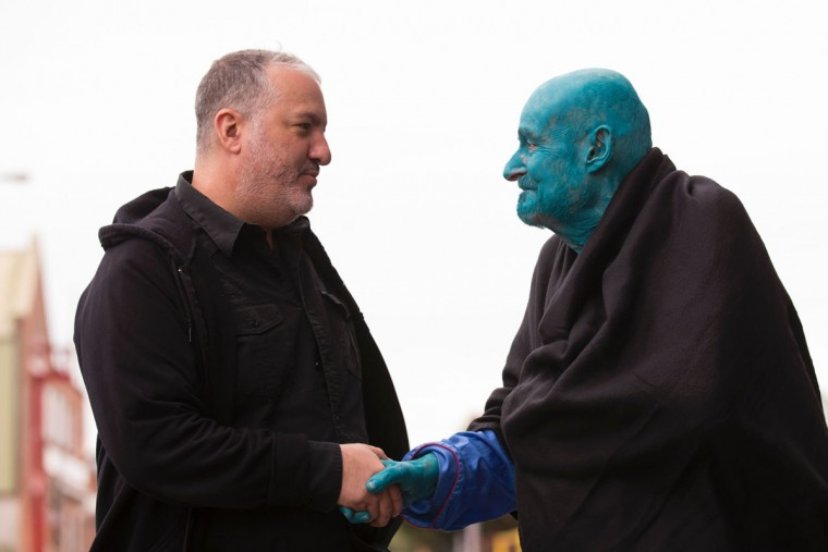 "US artist Spencer Tunick (L), shakes hands with 80 year old Belgian, Arizona-based art collector Stephane Janssen who has participated in 20 of Turnick's installations after around 3000 naked volunteers, painted in blue to reflect the colours found in Marine paintings in Hull's Ferens Art Gallery, participate in US artist, Spencer Tunick's ""Sea of Hull"" installation on the Scale Lane swing bridge in Kingston upon Hull on July 9, 2016. Over a period of 20 years, the New York based artist has created over 90 art installations in some of the most culturally significant places and landmarks around the world including the Sydney Opera House, Place des Arts in Montreal, Mexico City, Ernest Happel Stadium in Vienna and Munich in Germany. (AFP PHOTO / JON SUPER )"