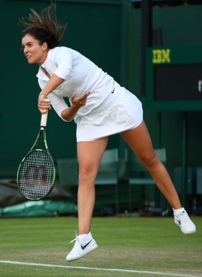 Laura Robson of Great Britain serves during the Ladies doubles first round match against Hao-Ching Chan and Yung-Jan Chan of Taipei on day four of the Wimbledon Lawn Tennis Championships at the All England Lawn Tennis and Croquet Club on June 30, 2016 in London, England. (Photo by Clive Brunskill/Getty Images)