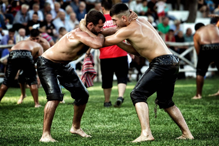Athletes take part in a competition of oil wrestling in Sohos, a village north of Thessaloniki on June 30, 2016. (SAKIS MITROLIDIS/AFP/Getty Images)