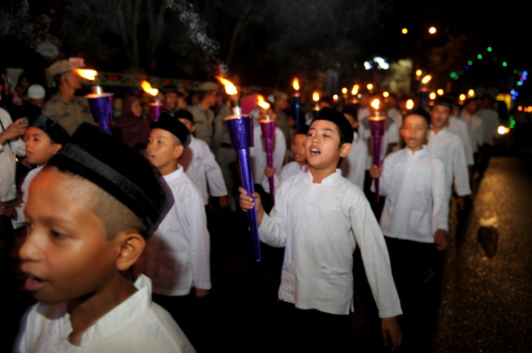 A group of Indonesian children sing Tuesday as they take part in a parade to mark Eid al-Fitr in Aceh. (CHAIDEER MAHYUDDIN/AFP/Getty Images)