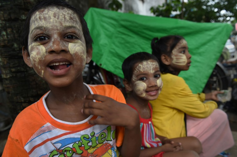 "Myanmar children wearing a ""thanaka"", a traditional facial cosmetic, wait for alms outside a mosque in Yangon on Wednesday on the eve of Eid al-Fitr celebrations. Myanmar's Muslim minority will celebrate Eid al-Fitr on Thursday. Myanmar police have detained five villagers for burning down a mosque last week, an officer said, as authorities look to contain religious violence in the Buddhist-majority nation. (ROMEO GACAD/AFP/Getty Images)"