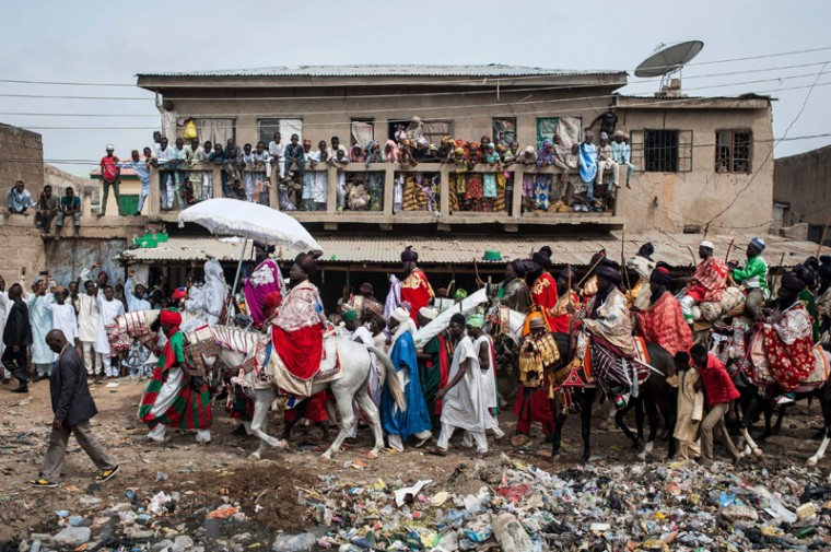 The Emir of Kano, Muhammadu Sanusi II, rides a horse as he parades with his entourage and musicians on the streets of Kano, northern Nigeria on Wednesday, during the Durbar Festival celebrating the Eid al-Fitr, which marks the end of the Islamic holy fasting month of Ramadan. (STEFAN HEUNIS/AFP/Getty Images)