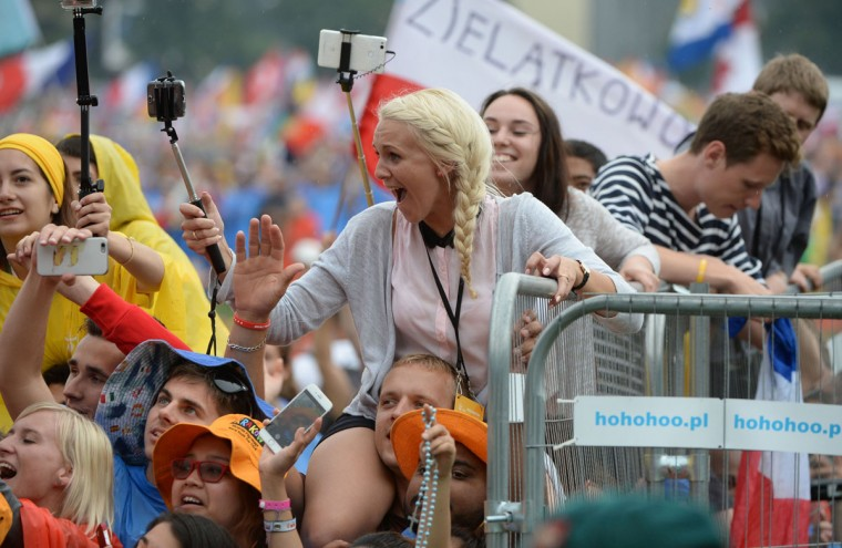 Pilgrims wait for Pope Francis to arrive at the opening ceremony of the World Youth Days at Blonia Park in Krakow, Poland. (FILIPPO MONTEFORTE/AFP/Getty Images)